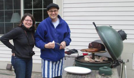 Here I am, showing the guest of honor the Big Green Egg hard at work