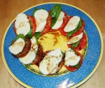 Caprese salad -- fresh heirloom tomatoes, fresh mozzarella and genovese basil