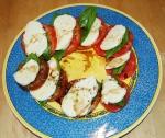 Caprese salad -- fresh heirloom tomatoes, fresh mozzarella and genovese basil