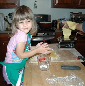 Photo of Norah, assisting me make pasta