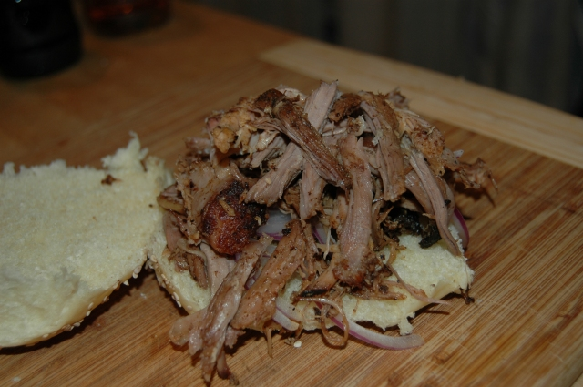 Freshly pulled pork on a Zingerman's Bakehouse roll with a few slices of red onion